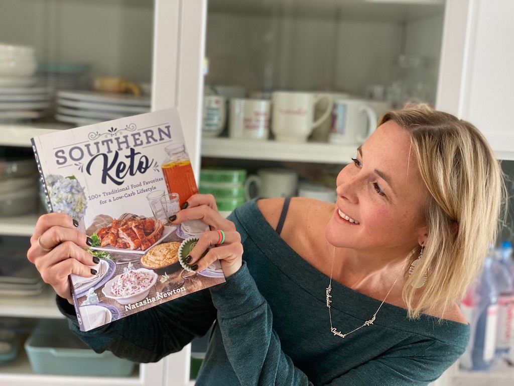 woman holding Southern keto Cookbook