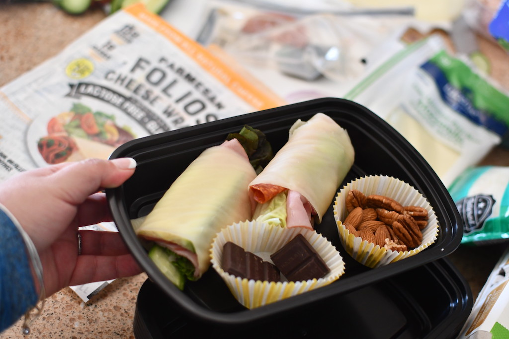 keto cheese wraps with nuts in meal prep container