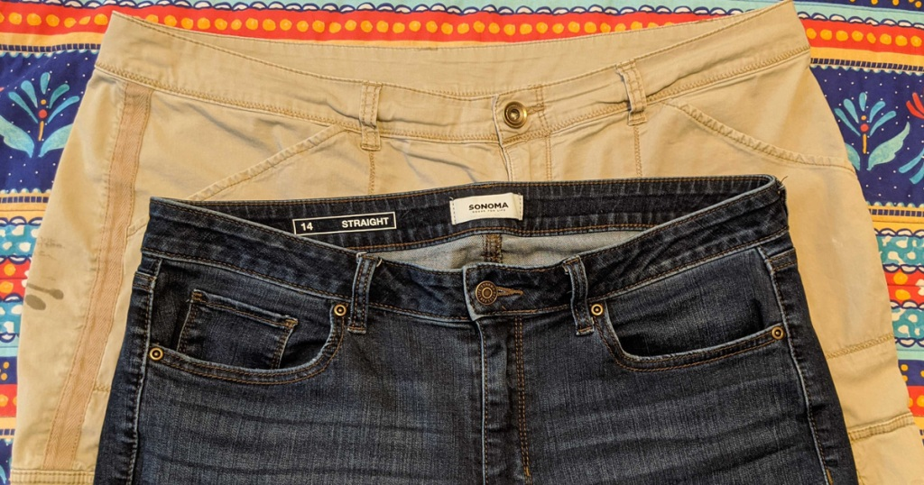 two pairs of pants laying on table