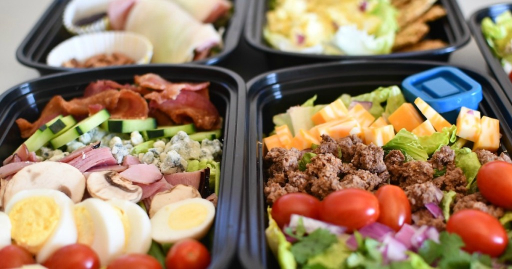 meal prep containers filled with keto lunches