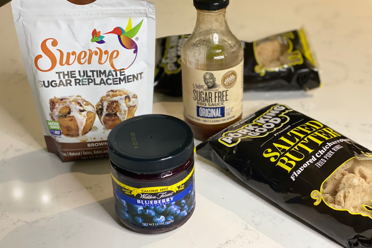 blueberry jam, sweets, and other keto groceries on counter