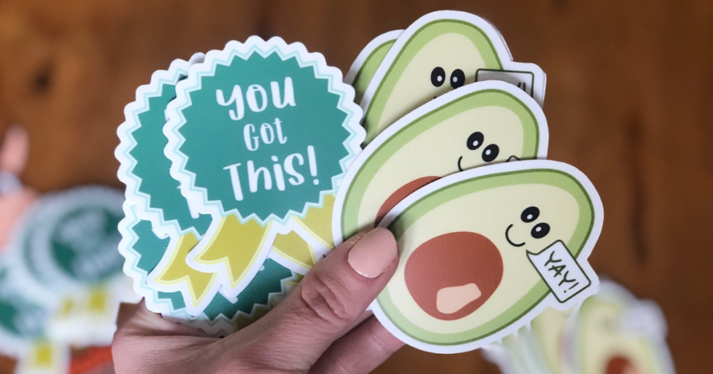 hand holding keto success stickers