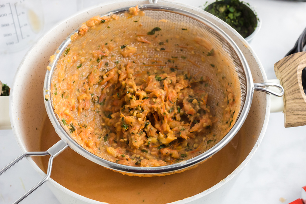 straining tomato basil keto soup