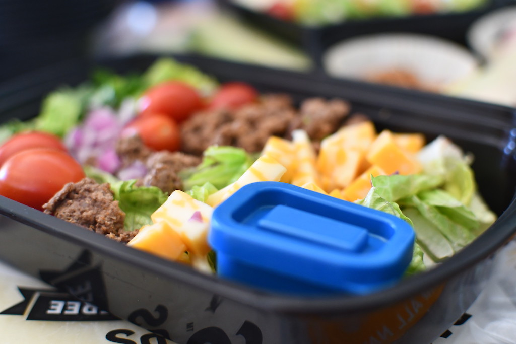 close up of keto taco salad in meal prep container