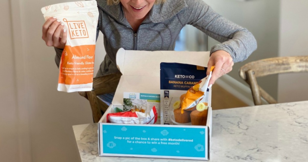 woman opening up keto delivered snack box