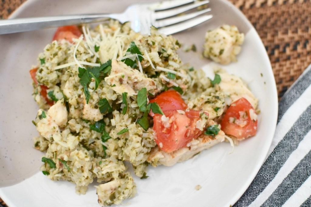 pesto chicken cauliflower rice on a plate