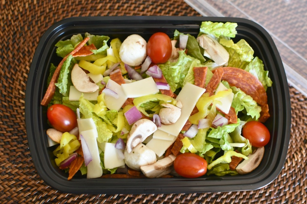 pizza salad in a container to go