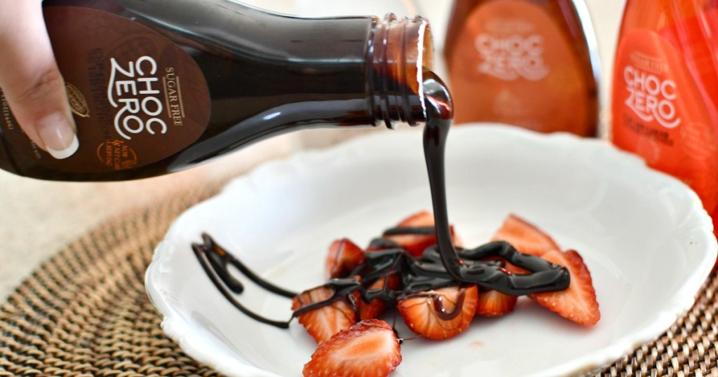 pouring choczero over strawberries