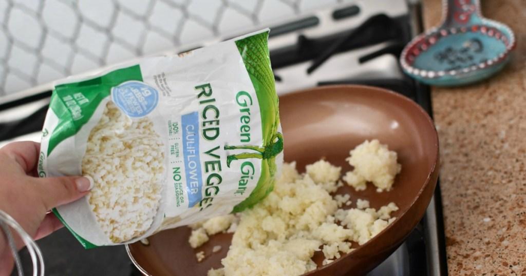 putting Green Giant frozen cauliflower rice in skillet