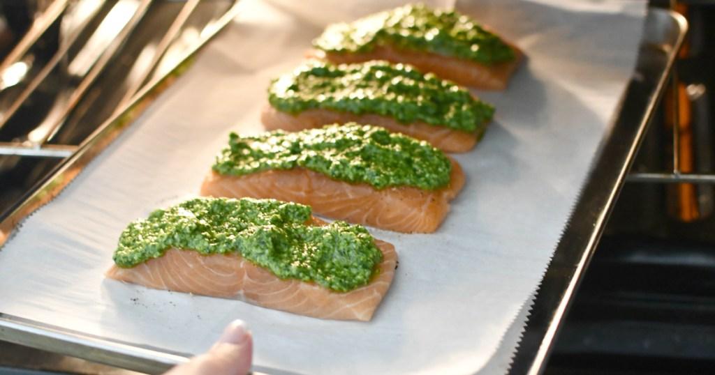 putting cilantro pesto salmon in the oven