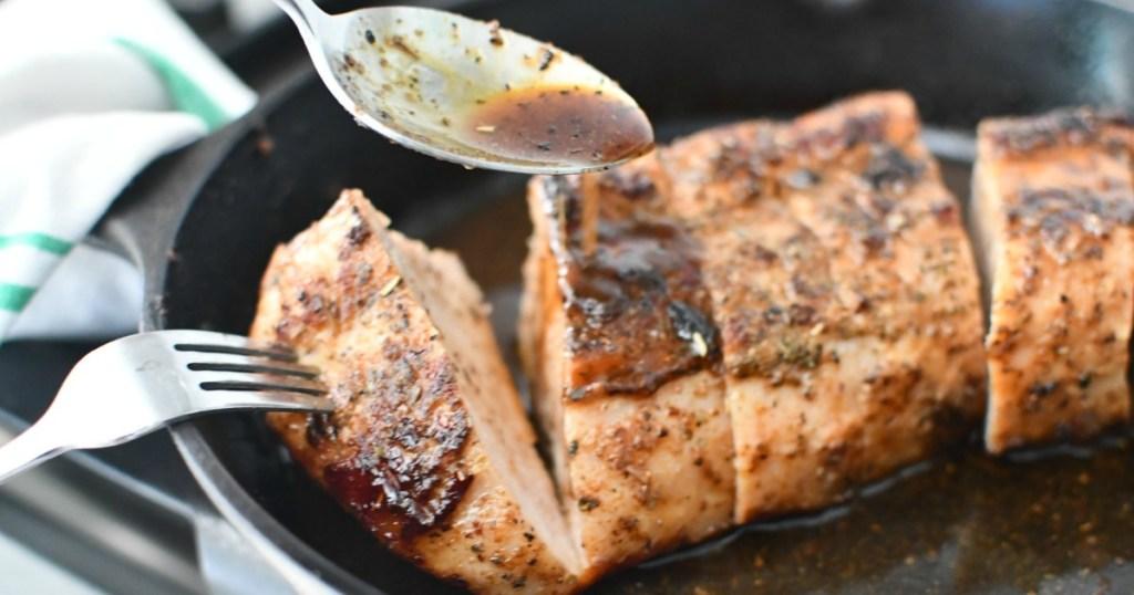 slicing up keto pork tenderloin