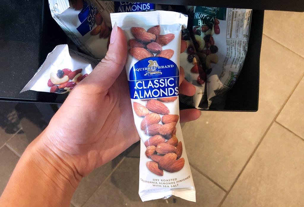 hand holding bag of almonds at starbucks