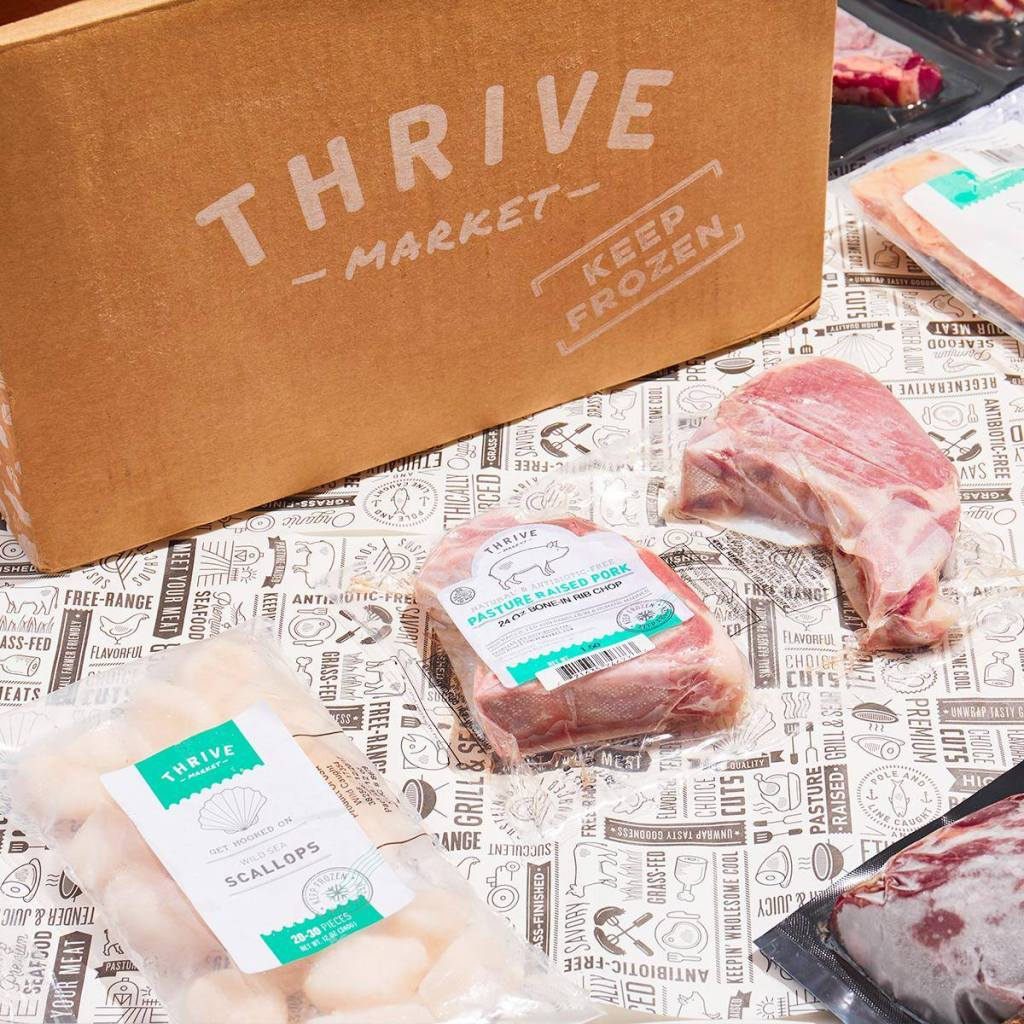 Thrive Market box with frozen fish on counter
