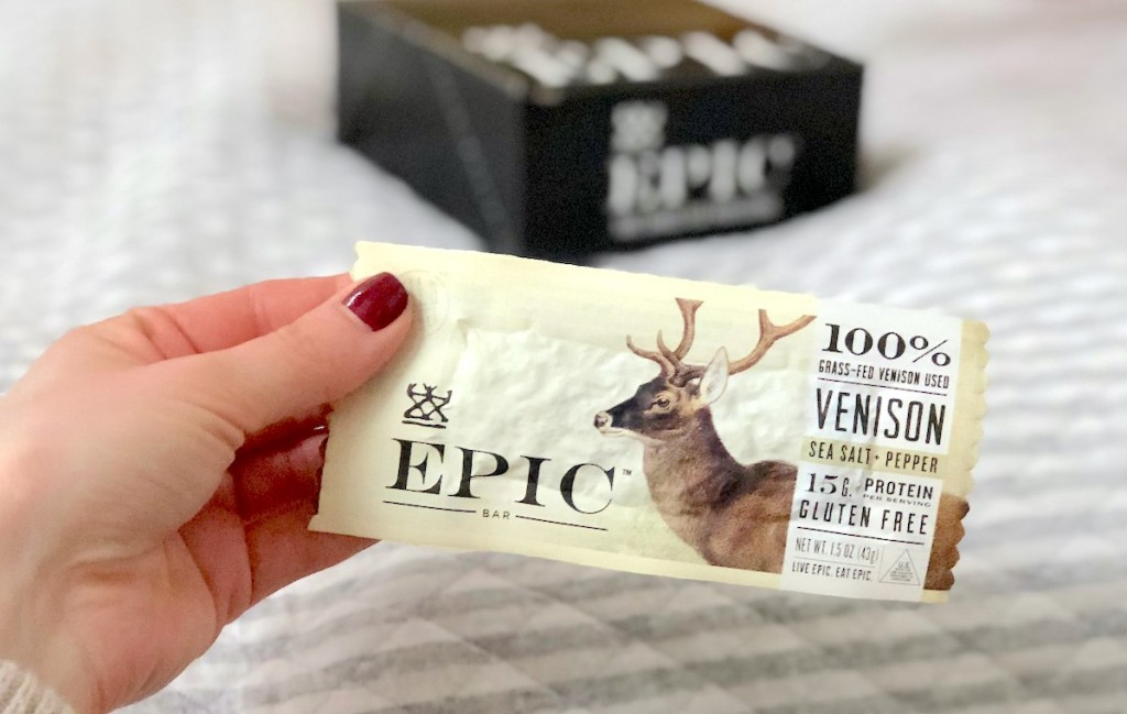 hand holding a venison epic protein bar