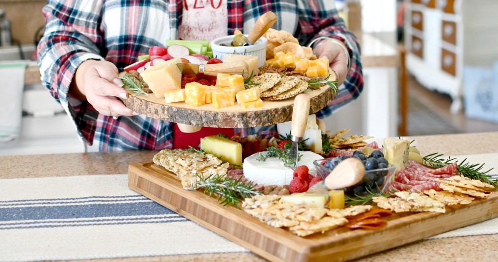 holding up keto charcuterie board