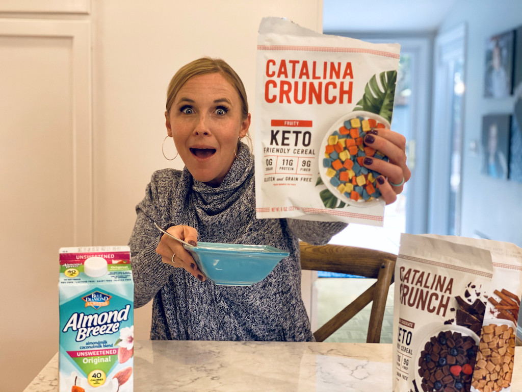 woman holding out Catalina Crunch Keto cereal