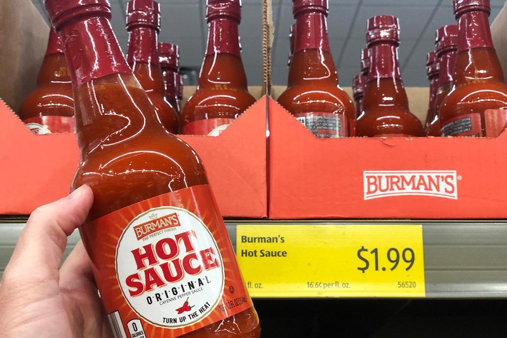 hand holding bottle of burmans hot sauce