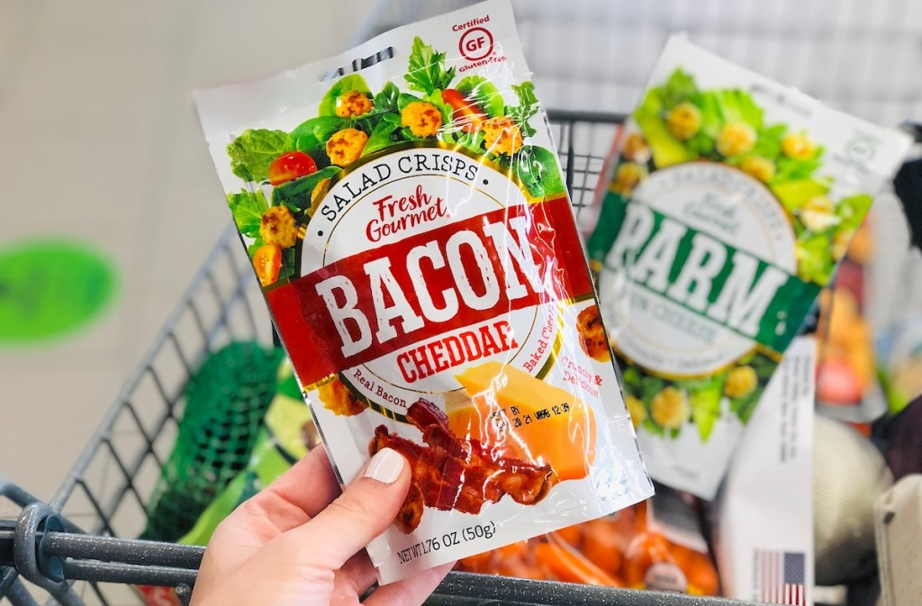 hand holding a bag of bacon cheese crisps