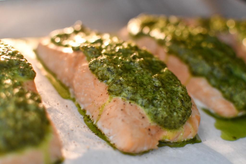 cilantro pesto salmon on parchment paper