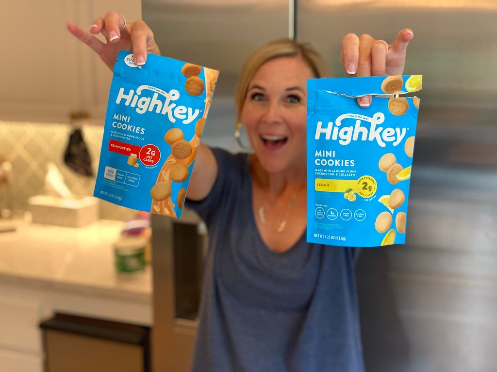 woman holding two HighKey cookie bags