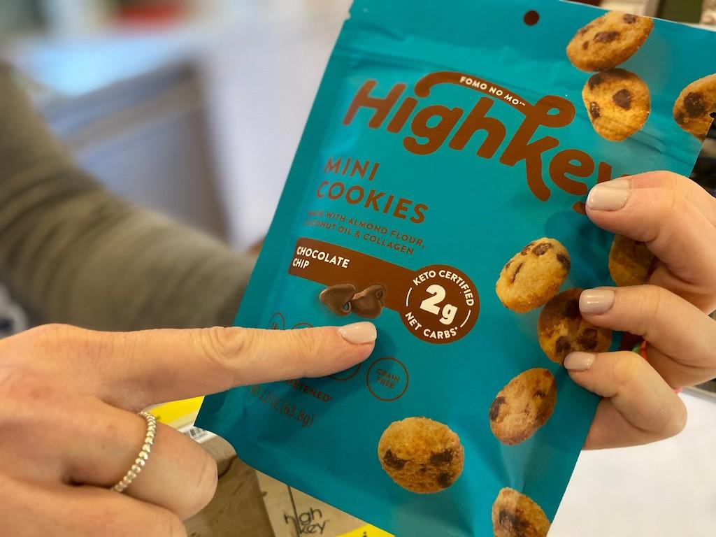 holding HighKey mini chocolate chip cookies bag