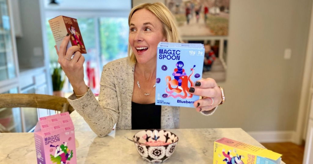 woman holding mini Magic Spoon cereal boxes
