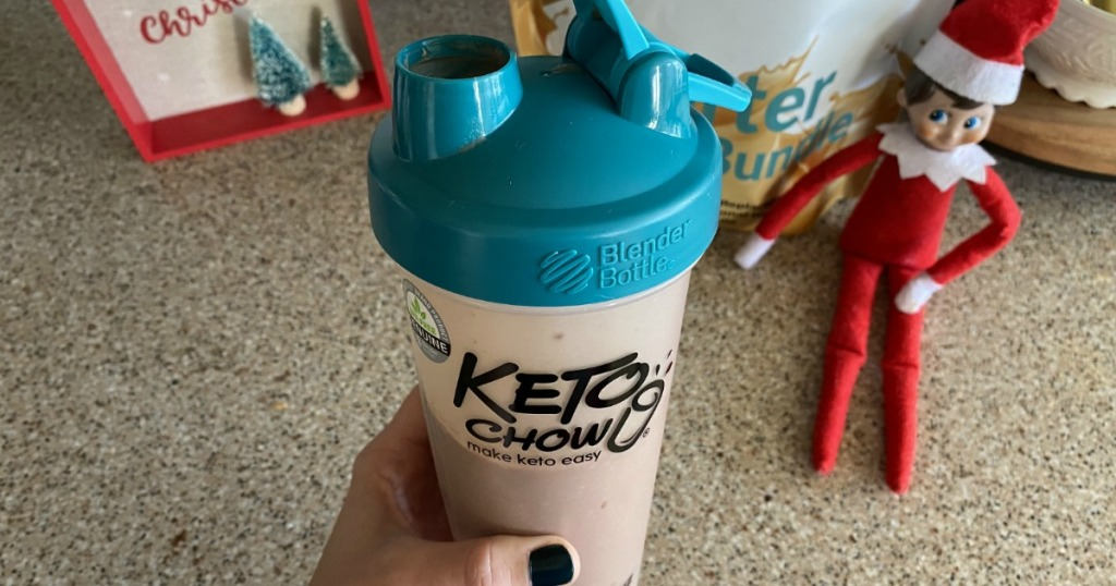 holding keto chow drink in shaker bottle