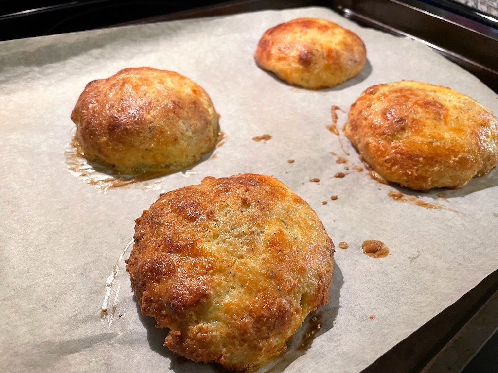 baked keto buns on parchment-lined sheet pan