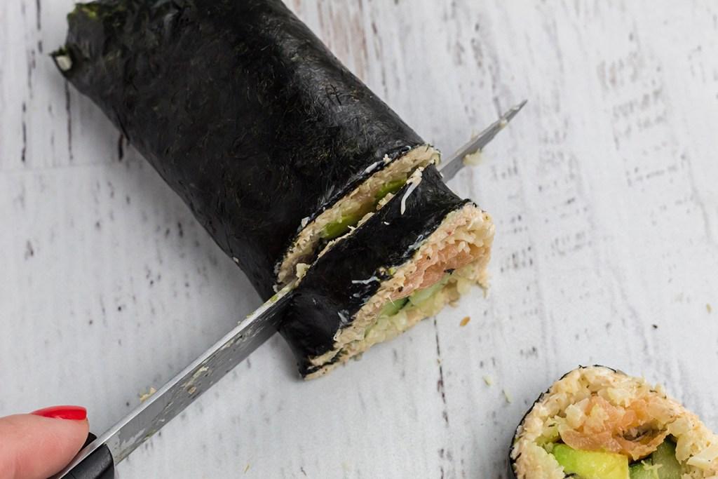 cutting roll of keto sushi