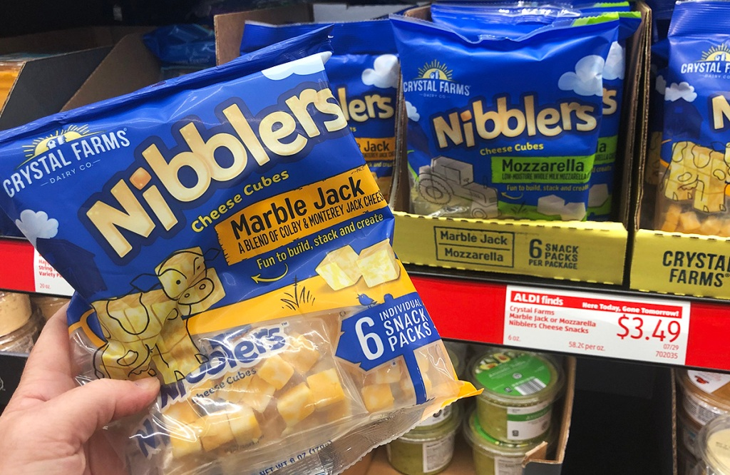 hand holding bag of cheese nibblers