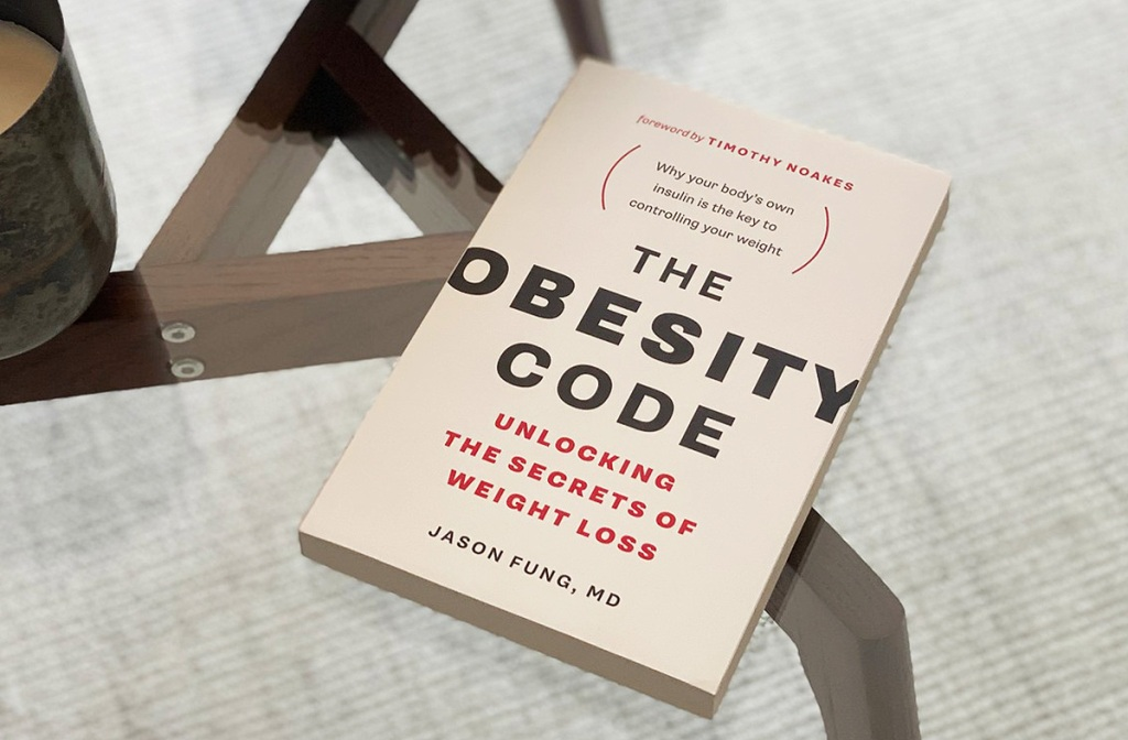 obesity code book on table