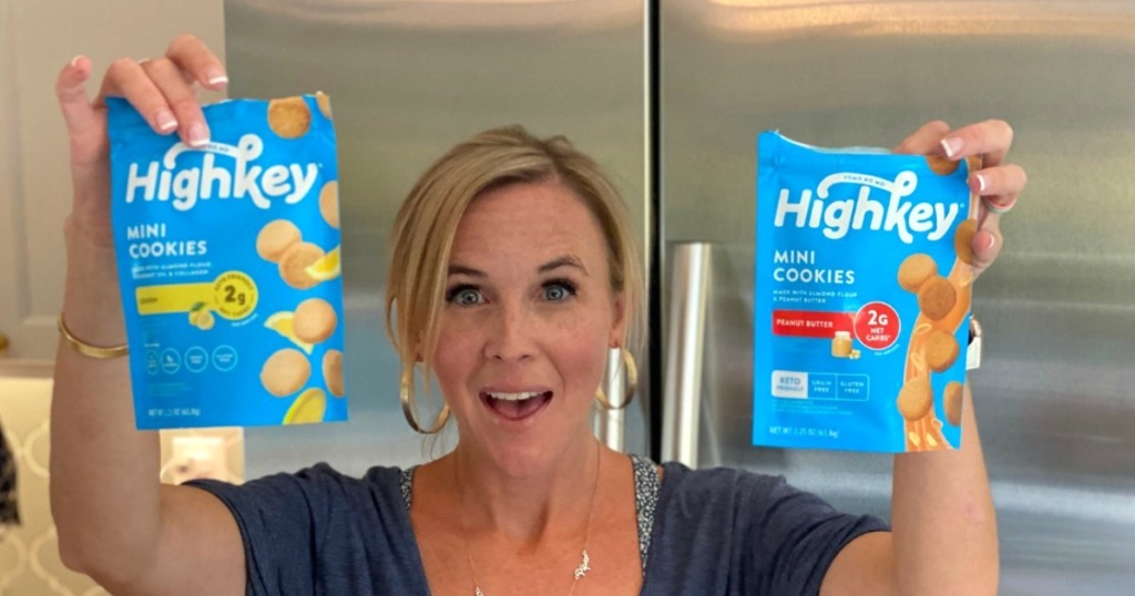 woman holding 2 bags of high key cookies