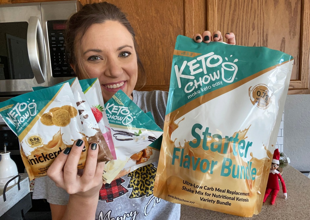 woman holding keto chow