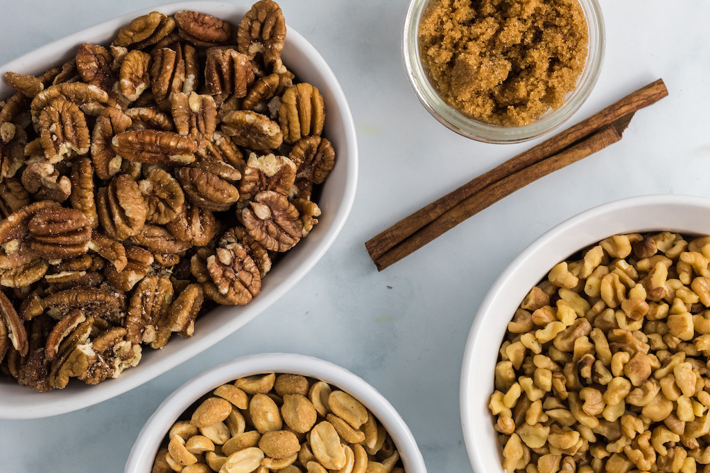 pecans, peanuts, and brown sugar in bowls