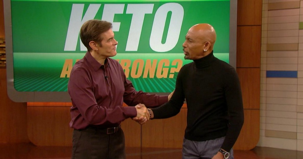 Montel Williams shaking hands with Doctor Oz