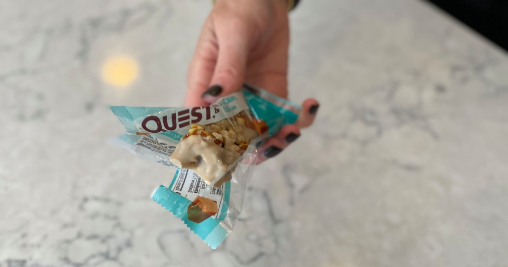 Hand holding a quest bar