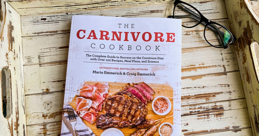 carnivore cookbook with pair of glasses