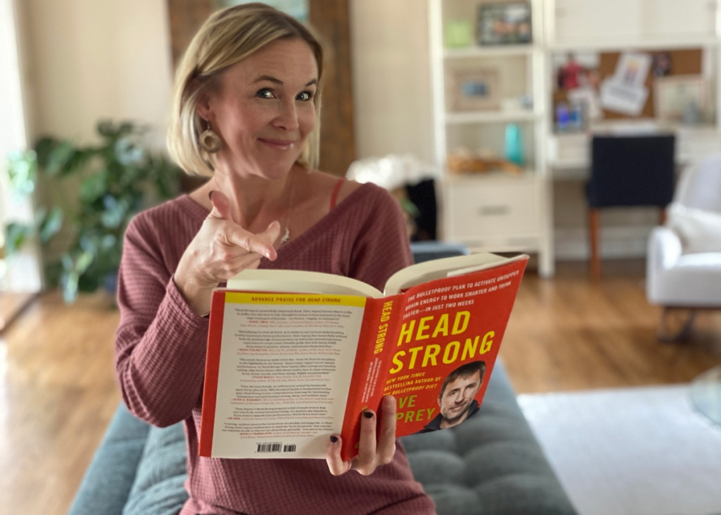 women with head strong book opened up