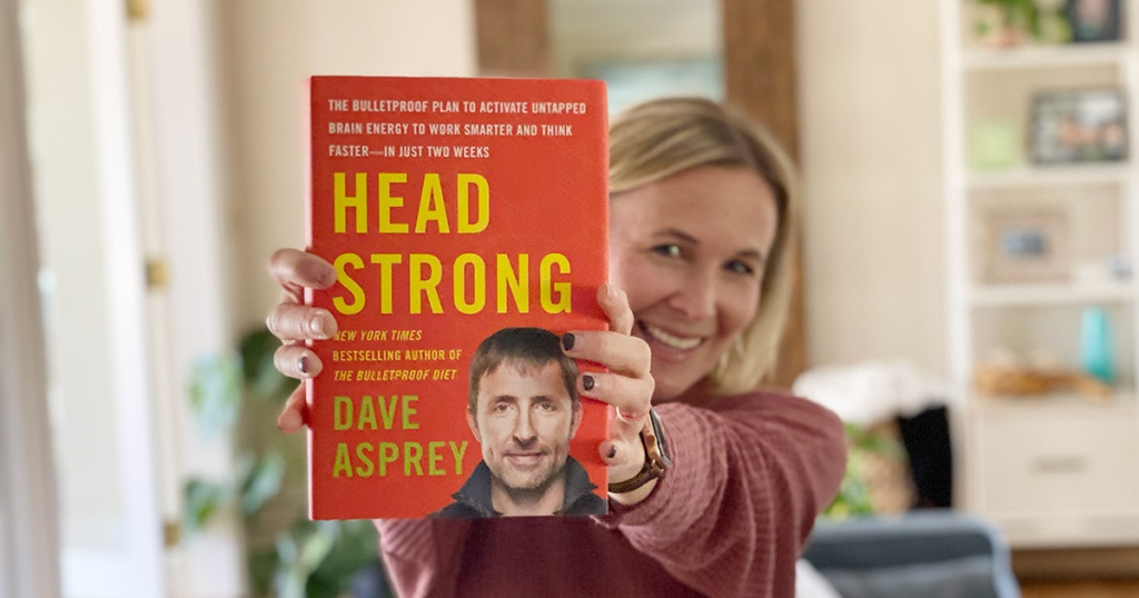woman holding up head strong by dave asprey