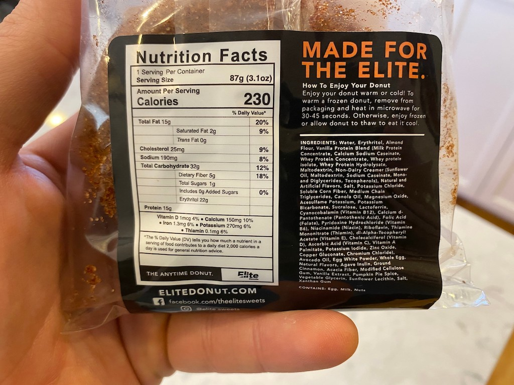 holding nutrition label of elite sweets donuts