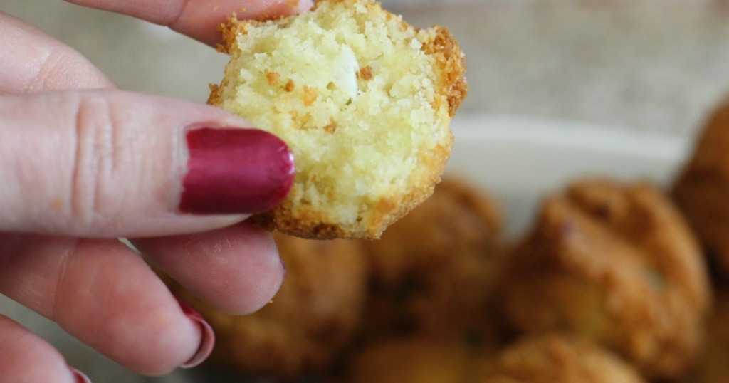 holding low-carb hushpuppy