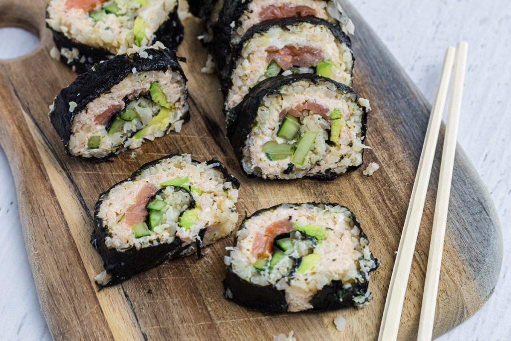 keto sushi roll pieces on cutting board