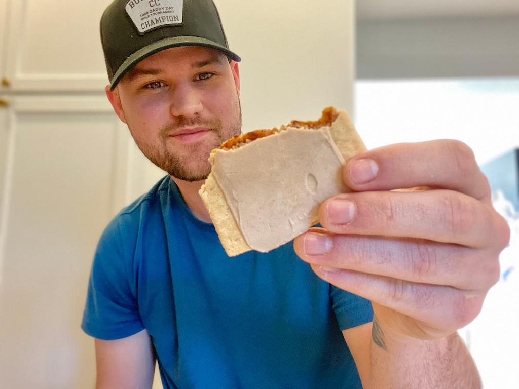 man holding keto cinnamon toaster pastry