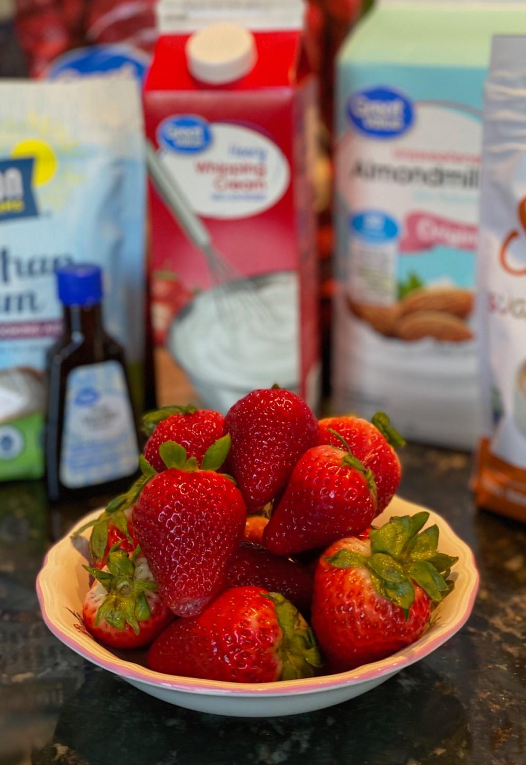 ingredients for keto strawberry milkshake on counter