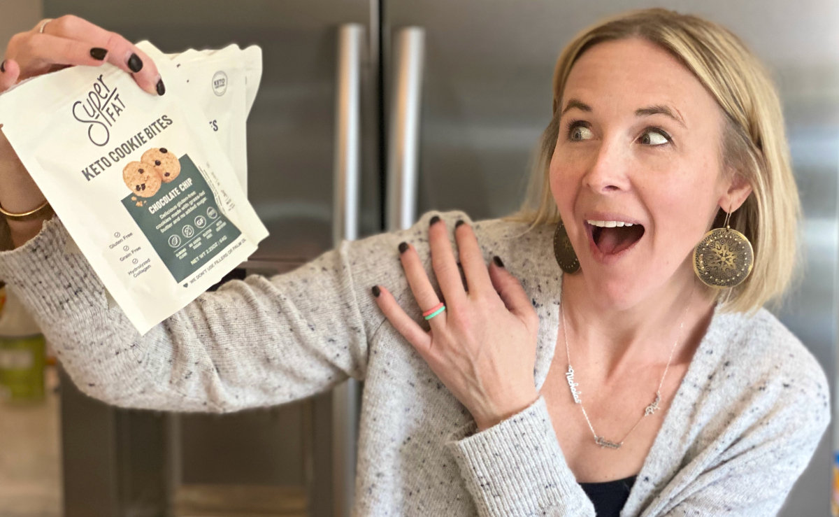 woman excited while holding superfat keto cookie bites bag