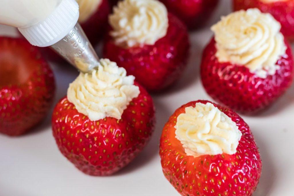 filling Keto Cheesecake-Stuffed Strawberries