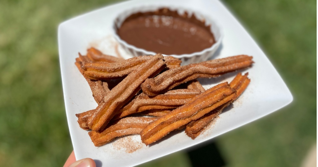 keto churros on a plate with chocolate