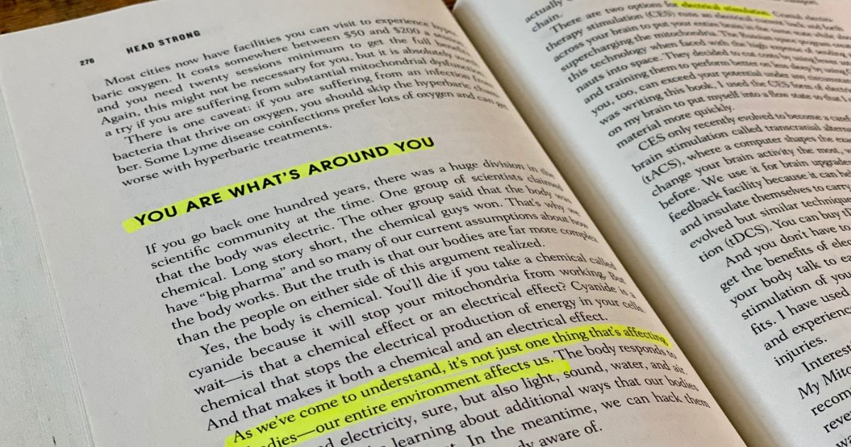 """Head Strong book open to a page with highlighted text """"You are what's around you"""""""