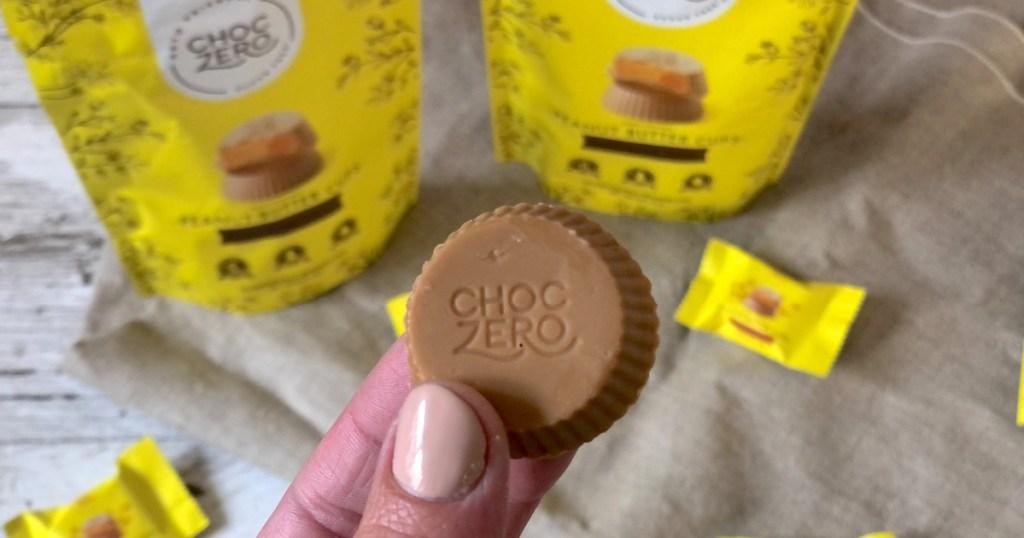 holding ChocZero peanut butter cup