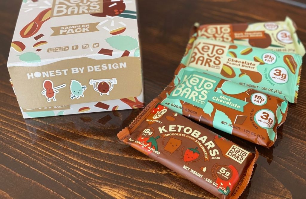 Keto snack bars on a table next to the box